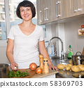 Portrait of happy brunette woman 58369703