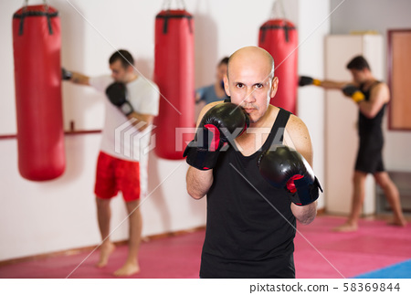 Portrait of boxer man which is practicing different kiks 58369844