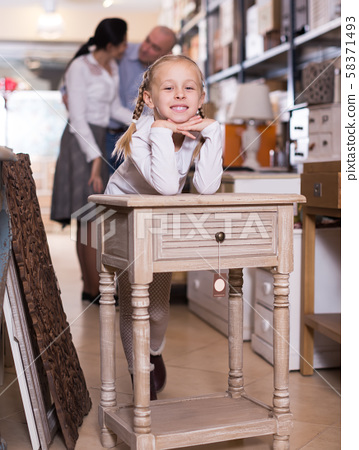 girl is satisfied of the modern furniture 58371493