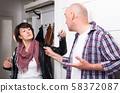Wife leaves house and gives keys to her husband. Home quarrel 58372087