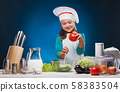 Girl Chef prepares a delicious dish on a blue background. 58383504