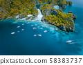 Aerial view of amazing Mililoc Island. Tourist boats near big Lagoon. El Nido, Palawan, Philippines 58383737