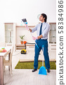 Young businessman cleaning the house 58384986