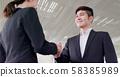 Businessman handshake with smile 58385989