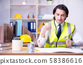 Young male architect working in the office 58386616