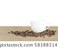 Coffee beans in coffee cup on white 58388314