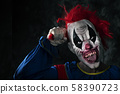 scary evil clown sticking out his tongue 58390723
