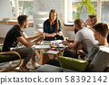 Group of young caucasian office workers have creative meeting to discuss new ideas 58392142