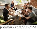 Group of young caucasian office workers have creative meeting to discuss new ideas 58392154