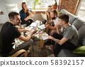 Group of young caucasian office workers have creative meeting to discuss new ideas 58392157