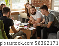 Group of young caucasian office workers have creative meeting to discuss new ideas 58392171