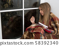 Christmas story time. Small child read book on 58392340
