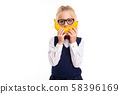 A little girl with blonde hair stuffed in a horse tail, large blue eyes and a cute face in square 58396169
