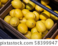 Many wooden boxes with fresh yellow lemons rich in nutrients 58399947