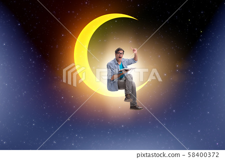Student reading book on the moon crescent 58400372