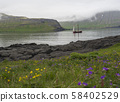 Vintage sailing ship in front of the high Hornbjarg cliffs hiden in fog at Hornstrandir national 58402529