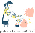 A woman watering flowers 58406953