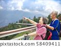 Asian Senior Couple hiking in the mountain park 58409411