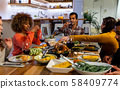 Millennial adult friends celebrating Thanksgiving together at home 58409774