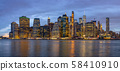 Panorama scene of New york Cityscape with Brooklyn Bridge beside the east river at the twilight time, USA downtown skyline, Architecture and building with tourist concept 58410910