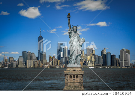 The Statue of Liberty over the Scene of New york cityscape river side which location is lower manhattan,Architecture and building with tourist concept 58410914
