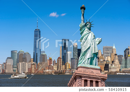 The Statue of Liberty over the Scene of New york cityscape river side which location is lower manhattan,Architecture and building with tourist concept 58410915