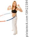 sporty fit girl doing exercise with hula hoop. 58422384