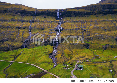 Aerial view of waterfalls in the village of Saksun on the Faroe islands 58425969
