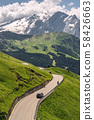 Idyllic Alps with road on green mountain hill 58426663