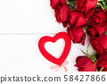 Red blooming roses on wood 58427866