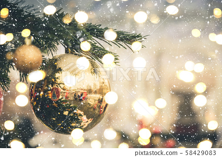 Christmas tree with golden balls. Xmas card and pattern. Close up. Winter. Outdoor. 58429083