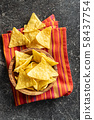 Corn nacho chips. Yellow tortilla chips 58437754