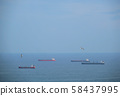 Cargo ships in sea and seagulls flying in the air 58437995
