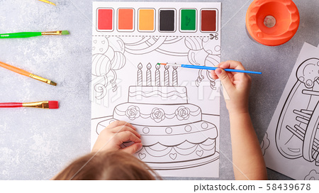 grey background, stationary, children's hands color a picture, flat lay top view. art painting, 58439678