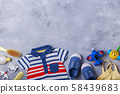 Small child or baby boy accessories on grey background travel with baby concept 58439683
