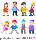 kids holding hands going to school with schoolbag 58444079
