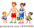 Happy family on summer vacation going to the beach 58444086