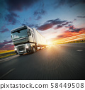 European truck vehicle with dramatic sunset light 58449508