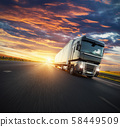 European truck vehicle with dramatic sunset light 58449509