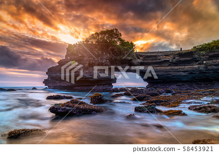Tanah Lot Temple on sea at sunset in Bali Island, 58453921