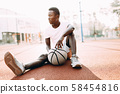 Sporty African American resting after a workout 58454816