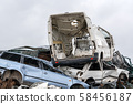 Old cars on the junkyard waiting for recycling 58456187