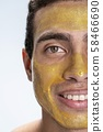 Happy young man caring of his skin 58466690