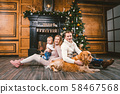 Theme Christmas and New Year family circle. Young Caucasian family with 1 year old child dog breed 58467568