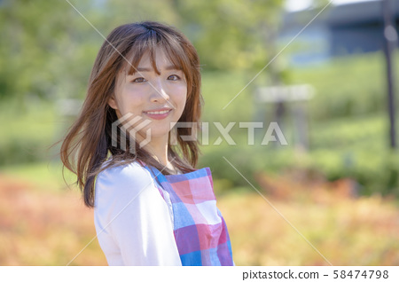Young woman apron outdoors 58474798