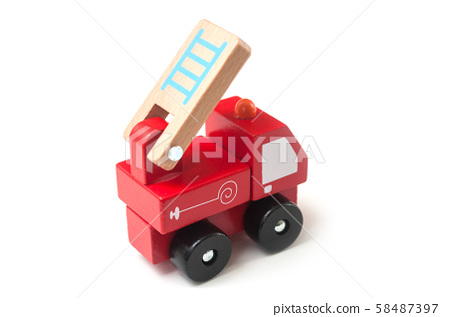 Closeup of miniature toy, wooden fire truck  58487397
