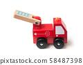 Closeup of miniature toy, wooden fire truck  58487398