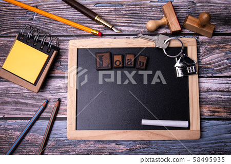 Loan, property, mortgage and real estate market concept. Chalkboard on a wooden background 58495935