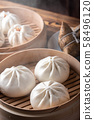 chinese steamed bun in traditional bamboo steamer 58496120