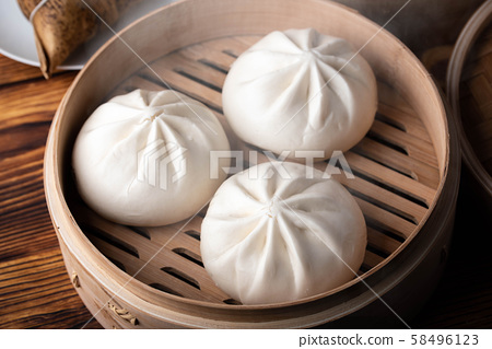 chinese steamed bun in traditional bamboo steamer 58496123